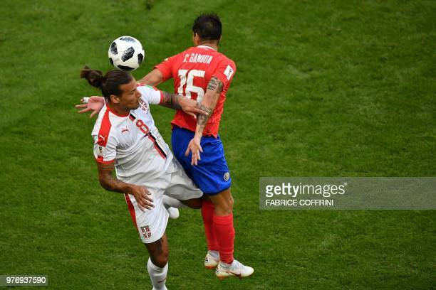 Serbia's forward Aleksandar Prijovic vies for the header with Costa Rica's defender Cristian Gamboa during the Russia 2018 World Cup Group E football...