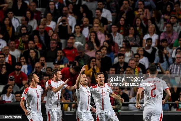 Serbia's forward Dusan Tadic celebrates a goal with teammates during the Euro 2020 qualifying group B football match between Portugal and Serbia at...