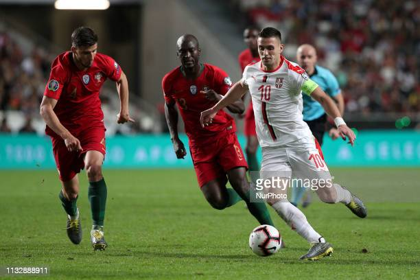 Serbia's forward Dusan Tadic vies with Portugal's defender Ruben Dias during the UEFA EURO 2020 group B qualifying football match Portugal vs Serbia...