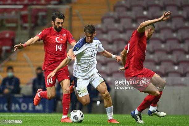 Serbia's forward Filip Djuricic is challenged by Turkey's midfielder Mahmut Tekdemir and midfielder Merih Demiral during the UEFA Nations League...