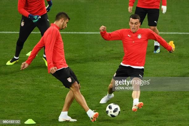 Serbia's forward Filip Kostic and Serbia's midfielder Marko Grujic take part in a training session at the Kaliningrad Stadium in Kaliningrad on June...