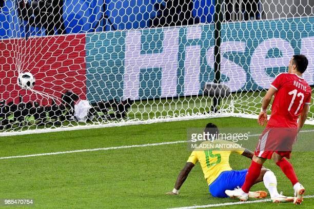 Serbia's forward Filip Kostic reacts as Brazil's midfielder Paulinho scores a goal during the Russia 2018 World Cup Group E football match between...