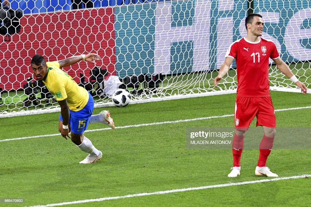 TOPSHOT - Serbia's forward Filip Kostic (R) reacts as Brazil's midfielder Paulinho (L) celebrates his goal during the Russia 2018 World Cup Group E football match between Serbia and Brazil at the Spartak Stadium in Moscow on June 27, 2018. (Photo by Mladen ANTONOV / AFP) / RESTRICTED
