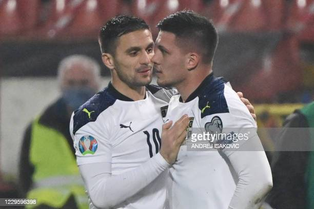 Serbia's forward Luka Jovic celebrates with Serbia's midfielder Dusan Tadic after scoring a goal during the Euro 2020 play-off qualification football...