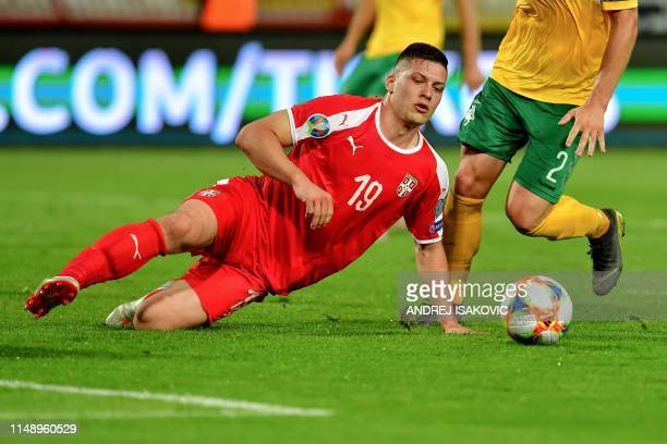 Serbia's forward Luka Jovic fights for the ball with Lithuania's defender Linas Klimavicius during the Euro 2020 football qualification match between...