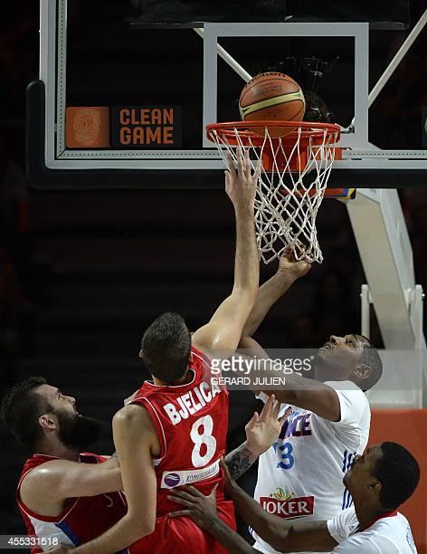 Serbia's forward Nemanja Bjelica scores next to France's forward Boris Diaw during the 2014 FIBA World basketball championships semifinal match...