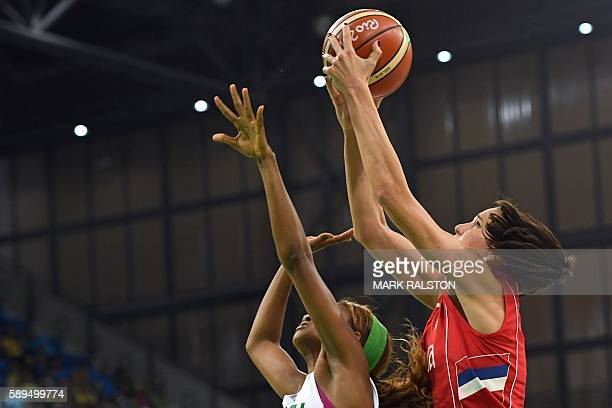 Serbia's forward Sonja Petrovic takes a shot over Senegal's shooting guard Oumoul Thiam during a Women's round Group B basketball match between...