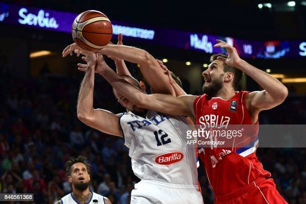 TOPSHOT Serbia`s forward Stefan Bircevic fights for the ball with Italy`s centre Marco Cusin during the FIBA Eurobasket 2017 men's quarterfinal...