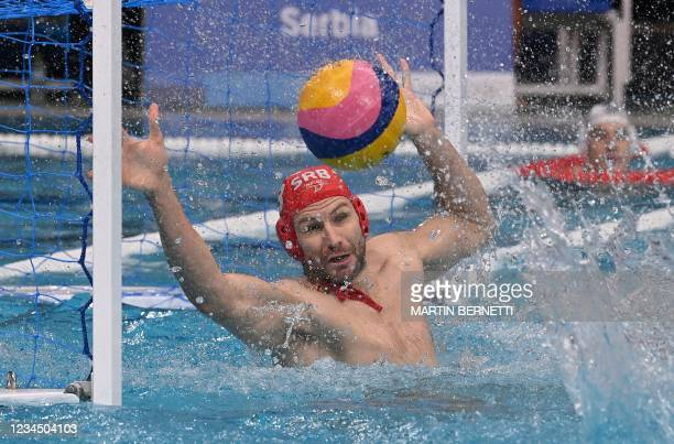 Serbia's goalkeeper Branislav Mitrovic makes a save during the Tokyo 2020 Olympic Games men's water polo semi-final match between Serbia and Spain at...
