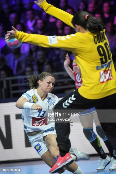 Serbia's goalkeeper Marija Colic vies with France's left wing Manon Houette during the Women Euro 2018 handball Championships Group 1 main round...