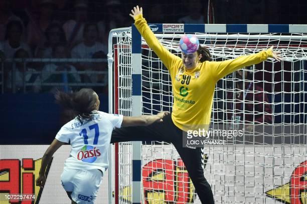 Serbia's goalkeeper Marija Colic vies with France's left wing Siraba Dembele Pavlovic during the Women Euro 2018 handball Championships Group 1 main...