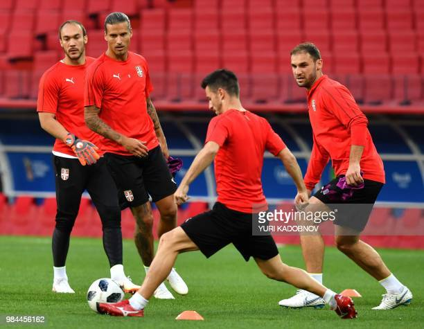 Serbia's goalkeeper Marko Dmitrovic and Serbia's forward Aleksandar Prijovic take part in a training session at the Spartak stadium in Moscow on June...
