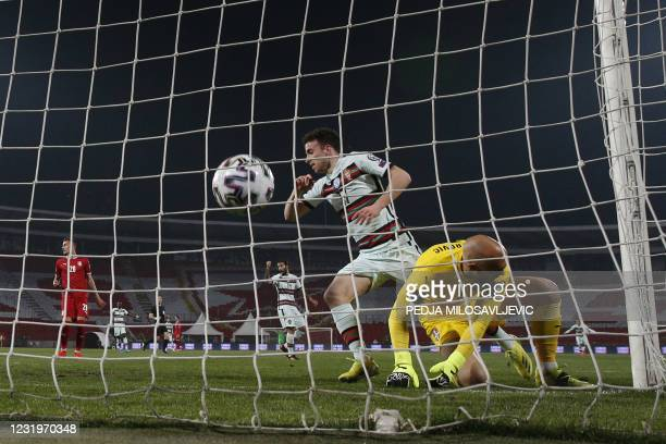 Serbia's goalkeeper Marko Dmitrovic concedes a goal scores by Portugal's forward Diogo Jota during the FIFA World Cup Qatar 2022 qualification Group...