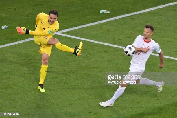 Serbia's goalkeeper Vladimir Stojkovic kicks the ball past Switzerland's forward Haris Seferovic during the Russia 2018 World Cup Group E football...