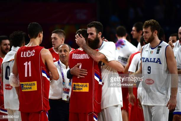 Serbia`s guard Bogdan Bogdanovic and Italy`s forward Luigi Datome embrace after the FIBA Eurobasket 2017 men's quarterfinal basketball match between...