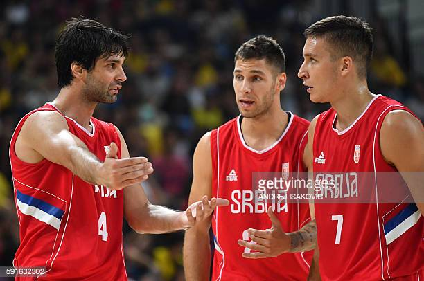 Serbia's guard Milos Teodosic speaks with Serbia's shooting guard Bogdan Bogdanovic during a Men's quarter final basketball match between Serbia and...