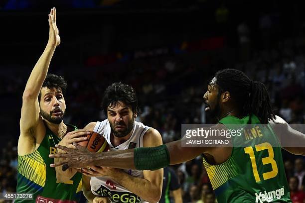 Serbia's guard Milos Teodosic vies with Brazil's forward Guilherme Giovannoni and Brazil's centre Nene Hilario during the 2014 FIBA World basketball...