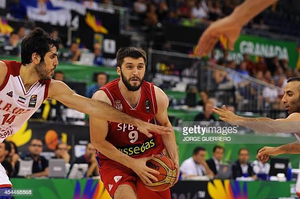 Serbia's guard Stefan Markovic vies with Iran's forward Samad Nikkhah Bahrami during the 2014 FIBA World basketball championships group A match Iran...