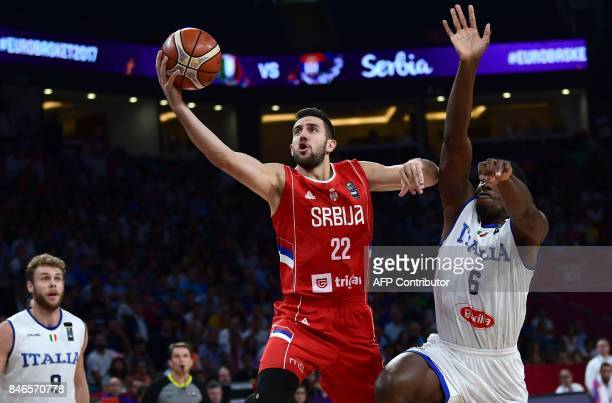 Serbia`s guard Vasilje Micic goes to the basket next to Italy`s center Paul Biligha during the FIBA Eurobasket 2017 men's quarterfinal basketball...