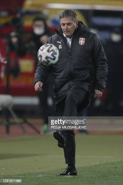 Serbia's head coach Dragan Stojkovic juggles with the ball during the FIFA World Cup Qatar 2022 qualification Group A football match between Serbia...