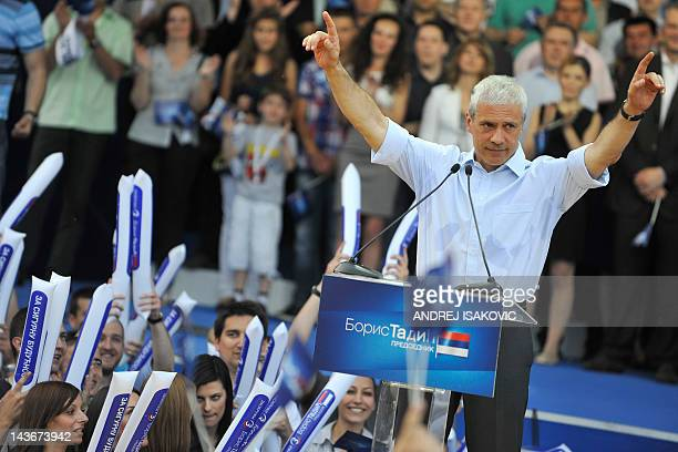 Serbia's incumbent President Boris Tadic gestures in front of supporters of the Democratic Party, during a rally in Belgrade, on May 2, 2012....