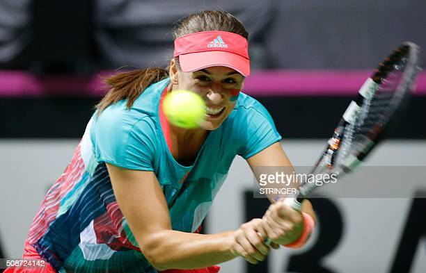 Serbia's Ivana Jorovic returns the ball to Spain's Garbine Muguruza during the Federation Cup tennis match between Serbia and Spain on February 6...