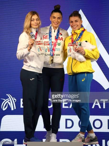 Serbia's Ivana Spanovic Belarus' Nastassia MironchykIvanova and Ukraine's Maryna BekhRomanchuk celebrate with their medals after the Women's Long...