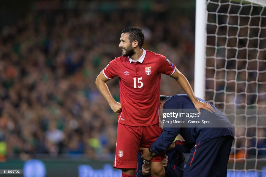 Serbias Jagos Vukovic gets treatment during the FIFA 2018 World Cup Qualifier between Republic of Ireland and Serbia at Aviva Stadium on September 5, 2017 in Dublin, .