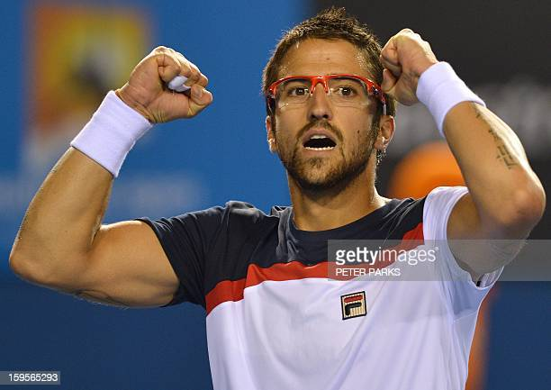 Serbia's Janko Tipsarevic celebrates after match point against Slovakia's Lukas Lacko during their men's singles match on day three of the Australian...