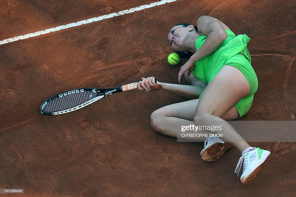 Serbia's Jelena Jankovic falls on the ground as she plays against Spain's Maria Jose Martinez Sanchez during the final of the WTA Rome Open on May 8, 2010. Martinez Sanchez defeated Jankovic 7-6, 7-5.