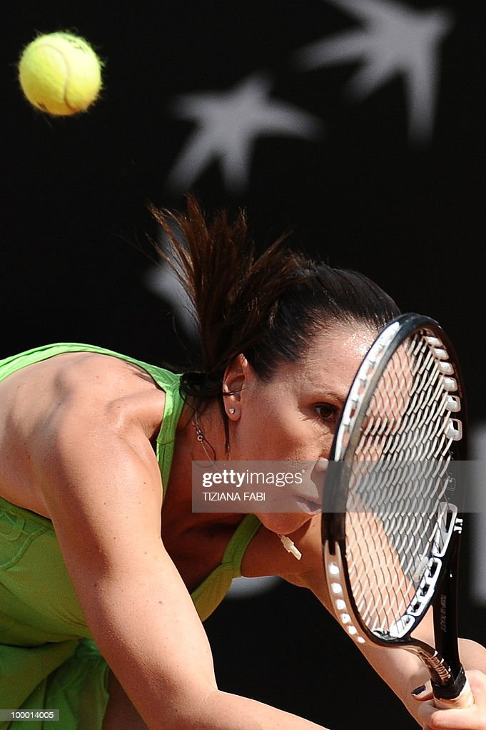 Serbia's Jelena Jankovic returns a ball to Spain's Maria Jose Sanchez Martinez during the final of the WTA Rome Open on May 8, 2010.