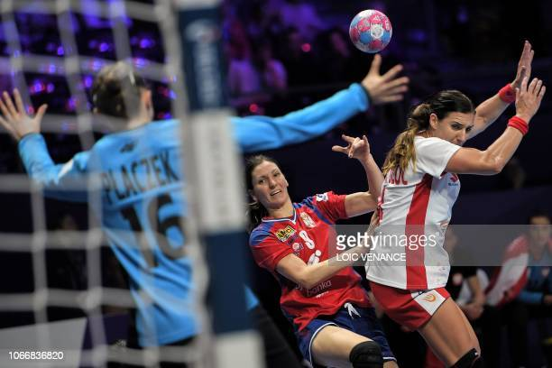 Serbia's Jelena Lavko vies with Poland's goalkeeper Adrianna Placzek during the group A preliminary round match Serbia vs Poland as part of the women...