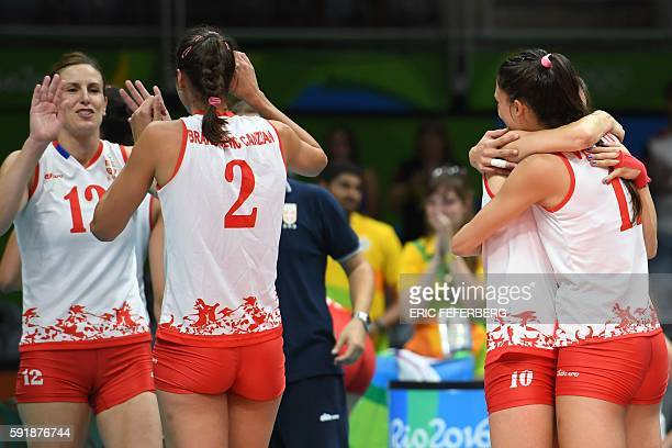 Serbia's Jelena Nikolic and teammates react after winning the women's semifinal volleyball match against USA at the Maracanazinho stadium in Rio de...