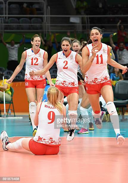 Serbia's Jelena Nikolic Serbia's Jovana Brakocevic and Serbia's Stefana Veljkovic react with teammates after winning their women's semifinal...