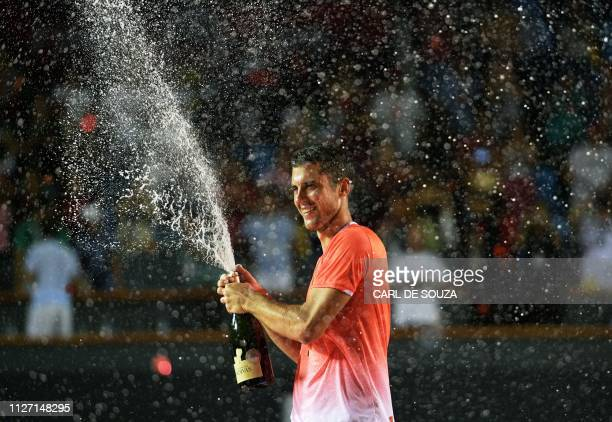 TOPSHOT Serbia's Laslo Djere celebrates after beating Canada's Felix AugerAliassime in the ATP World Tour Rio Open singles final match at the Jockey...