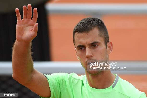 Serbia's Laslo Djere celebrates after winning against Australia's Alexei Popyrin during their men's singles second round match on day four of The...