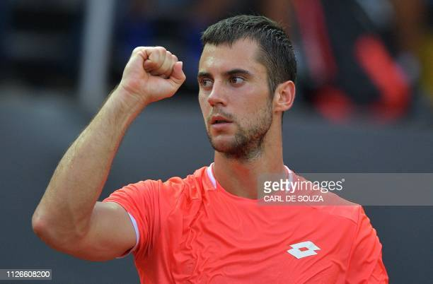 Serbia's Laslo Djere celebrates after winning against Japan's Taro Daniel during their ATP World Tour Rio Open singles match at the Jockey Club in...