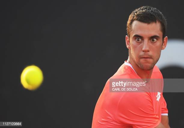 Serbia's Laslo Djere eyes the ball during the ATP World Tour Rio Open singles final match against Canada's Felix AugerAliassime at the Jockey Club in...