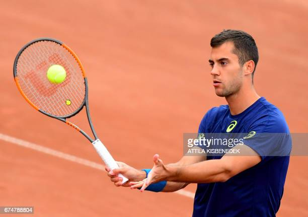 Serbia's Laslo Djere returns the ball to Britain's Aljaz Bedene during their semifinal tennis match at the Hungarian Open in Budapest on April 29...