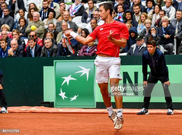 Serbia's Laslo Djere returns the ball to France's JoWilfried Tsonga during their Davis Cup world group semifinal tennis match between France and...
