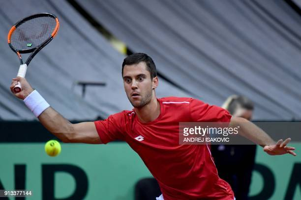 Serbia's Laslo Djere returns the ball to US tennis player Sam Querrey during the Davis Cup World Group first round single match between Serbia and...