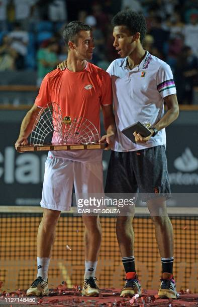 Serbia's Laslo Djere stands next to Canada's Felix AugerAliassime on the podium after the ATP World Tour Rio Open singles final match at the Jockey...