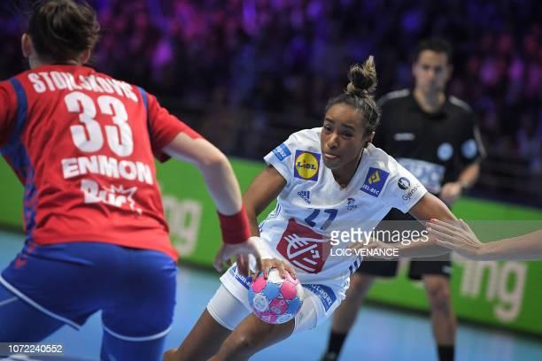 Serbia's left back Jovana Stoiljkovic vies with France's center back Estelle Nze Minko during the Women Euro 2018 handball Championships Group 1 main...