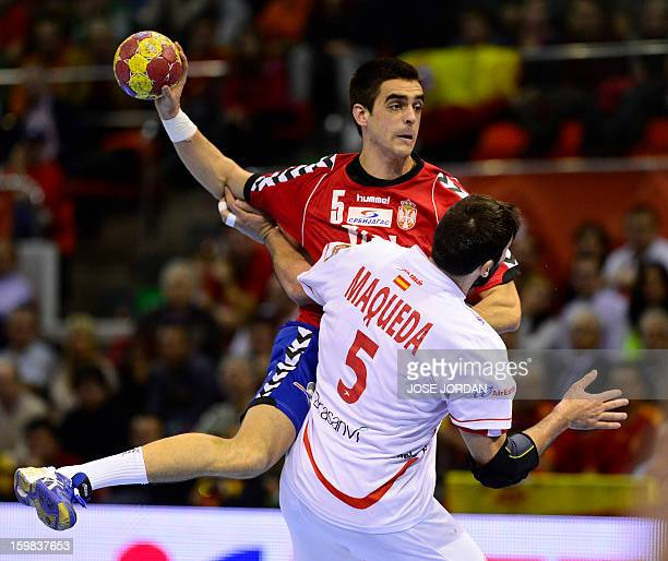 Serbia's left back Zarko Sesum vies with Spain's right back Jorge Maqueda during the 23rd Men's Handball World Championships round of 16 match Serbia...