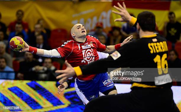 Serbia's left wing Ivan Nikcevic vies with Spain's goalkeeper Arpad Sterbik during the 23rd Men's Handball World Championships round of 16 match...