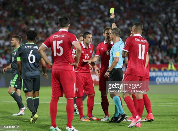 Serbia's Luka Milivojevic is shown a yellow card by referee Manuel de Sousa after conceding a penalty for a foul on Wales' Sam Vokes during the 2018...