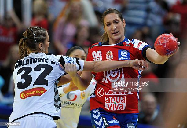 Serbia's Marina Dmitrovic vies with Montenegro's Katarina Bulatovic during the Women's EHF Euro 2012 Handball Championship semi-final match Serbia vs...