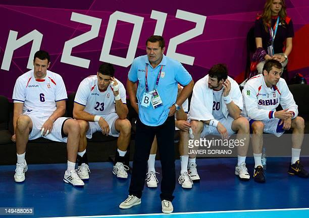 Serbia's Marko Vujin Nenad Vuckovic coach Veselin Vukovic and leftback Momir Rnic attend the men's preliminaries Group B handball match Spain vs...