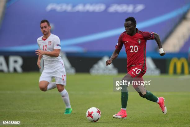 Serbia's midfielder Andrija Zivkovic and Portugal's midfielder Bruma vie for the ball during the UEFA U21 European Championship Group B football...