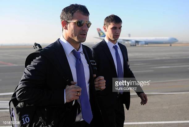 Serbia's midfielder Dejan Stankovic and defender Branislav Ivanovic arrive at O.R. Tambo international airport in Johannesburg on June 8, 2010 ahead...